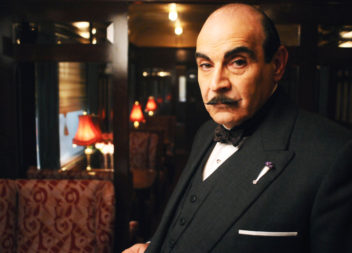 David Suchet as Hercule Poirot. Poirot investigates the murder of a shady American businessman stabbed in his compartment on the Orient Express when it is blocked by a blizzard in the Serbian mountains.