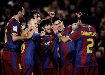 BARCELONA, SPAIN - FEBRUARY 05:  Lionel Messi of Barcelona (3rdR) celebrates with his teammates after scoring his first team's goal during the La Liga match between Barcelona and Atletico de Madrid at Camp Nou on February 5, 2011 in Barcelona, Spain.  (Photo by David Ramos/Getty Images)